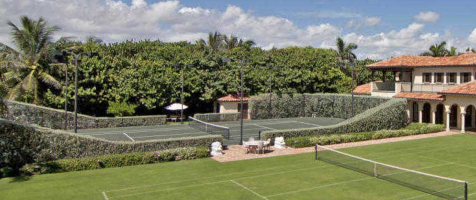 Custom trimmed bushes/shrubs around a tennis court at Manalapan, FL estate.
