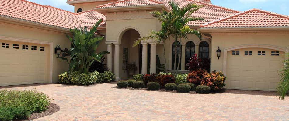 Beautiful landscaping installation in the front of a home in Palm Beach, %%state.