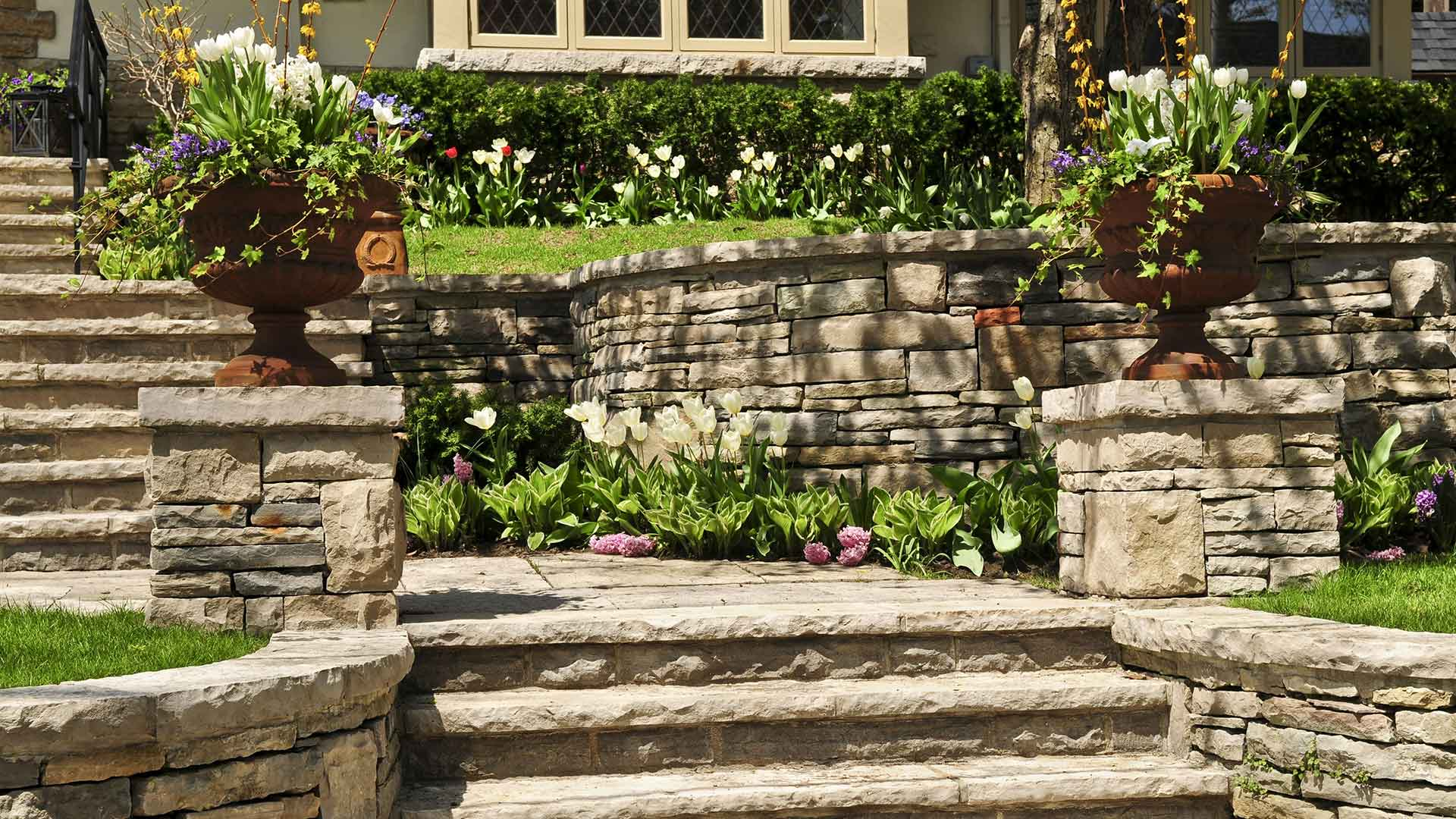 We partnered with a local contractor to install these plants and custom stone steps in Palm Beach, FL.