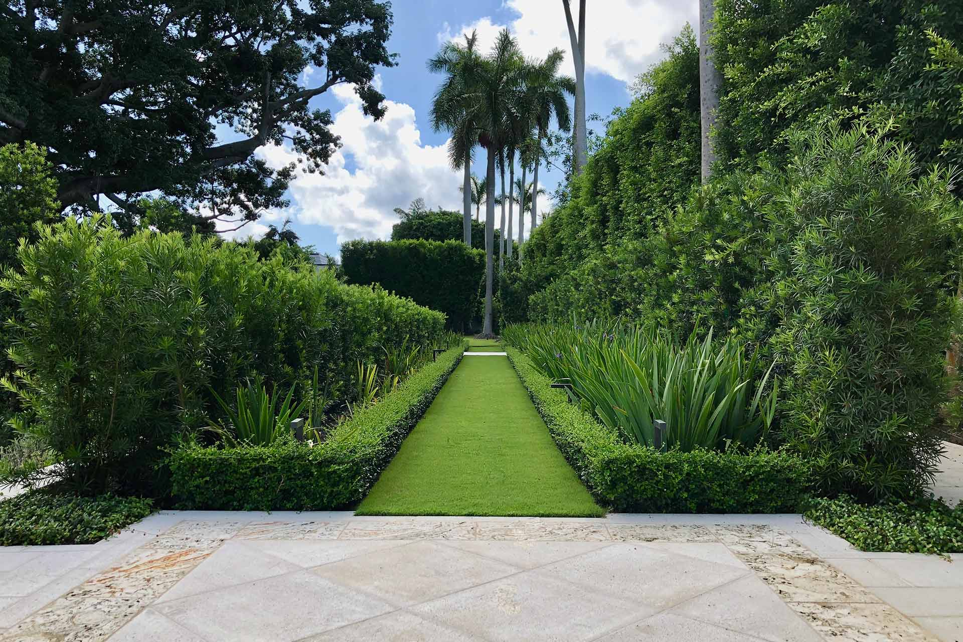 Landscaping and garden path at an estate in Palm Beach, FL.