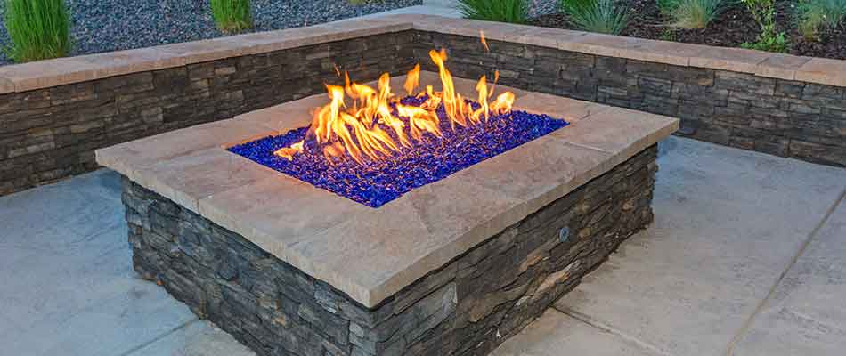 This custom fire pit in Jupiter, FL complements the surrounding area.