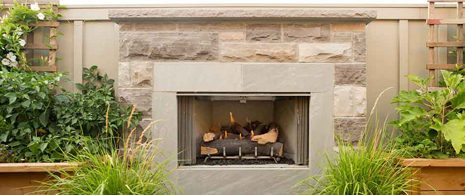 A custom fireplace can add a focal point to your outdoor living space in Palm Beach, FL.