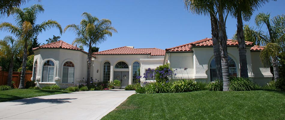 This home in Wellington, FL has custom landscaping and a lawn maintenance program.