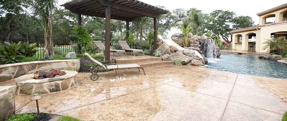 This Gulf Stream, FL homeowner is enjoying their new patio, fire pit, pool, and more.