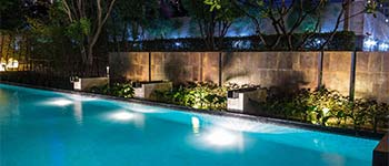 Custom water features surrounding a pool in Palm Beach, FL.