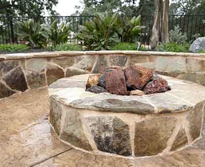 A custom fire pit and seating wall in Jupiter, FL.